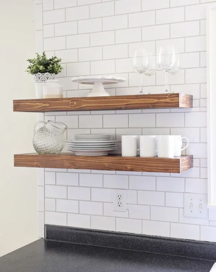 Add some warmth to the kitchen with wooden shelves