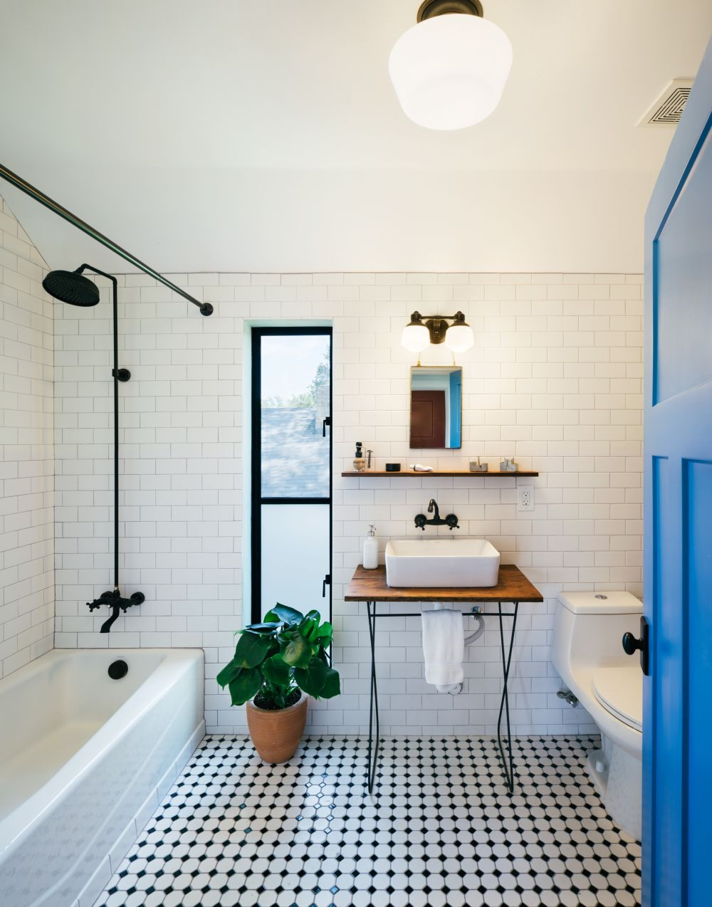 The subway tiles and give the bathroom walls a simple and elegant look