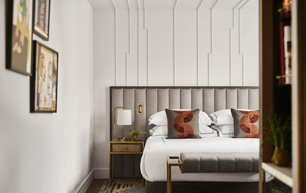 Vertical channels look and chic on a modern headboard.