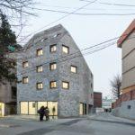 Beyond the Screen brick facade - OBBA