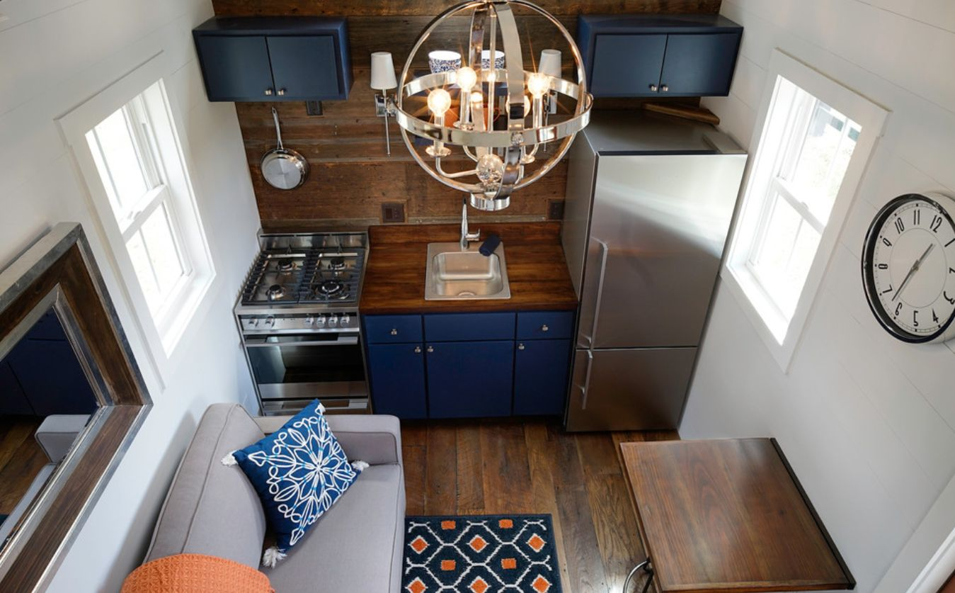 Dark wood kitchen with blue accents