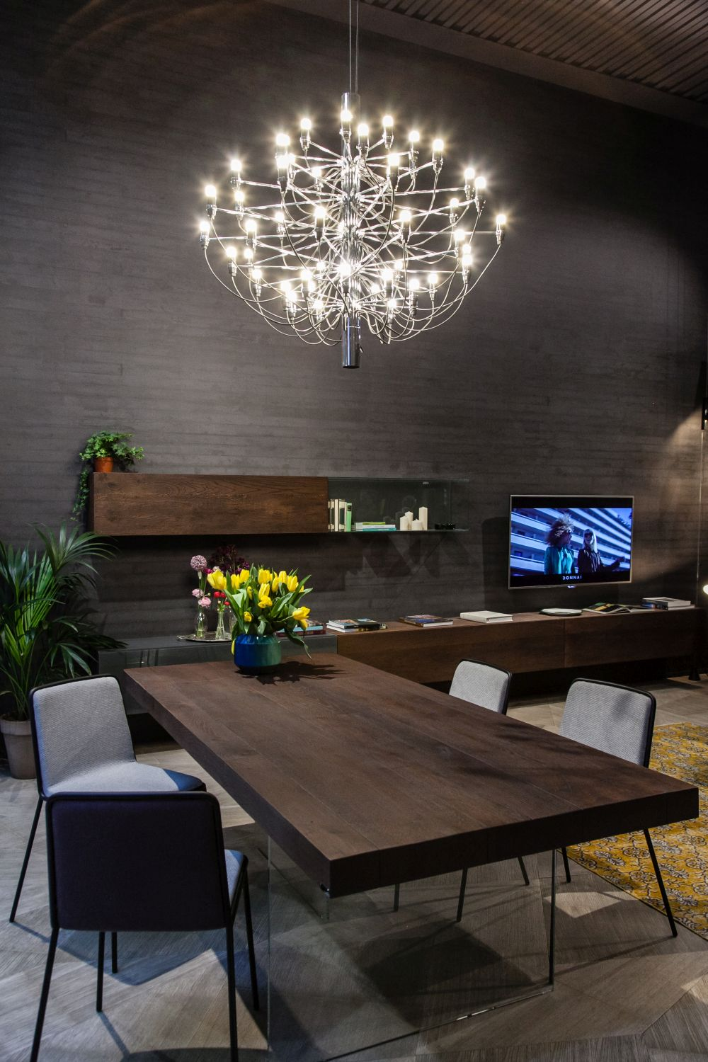 Make a large and sophisticated chandelier the focal point of the entire floor plan, not just the dining area