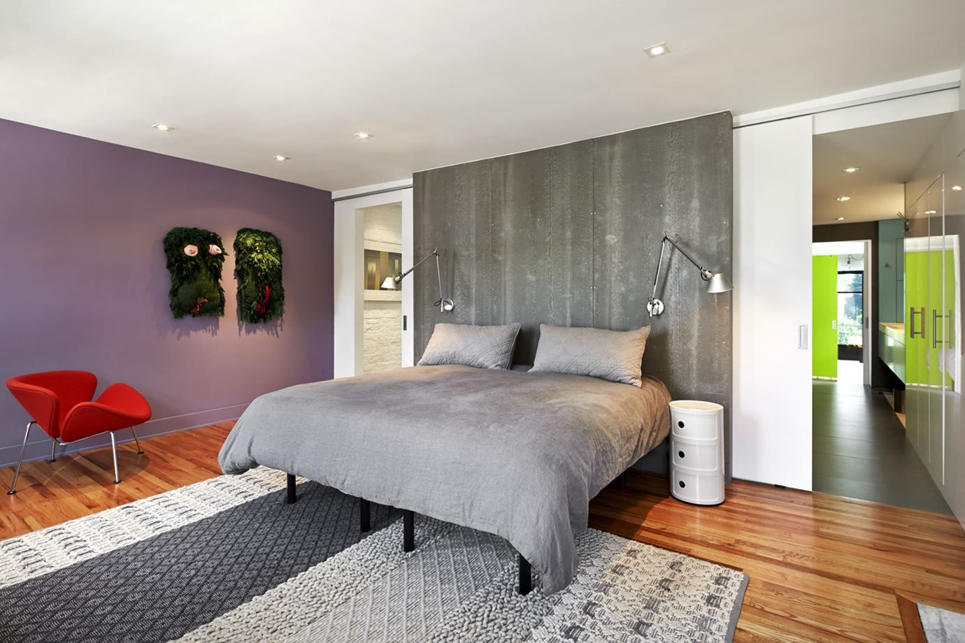 Concrete panels are a chic choice for a headboard.