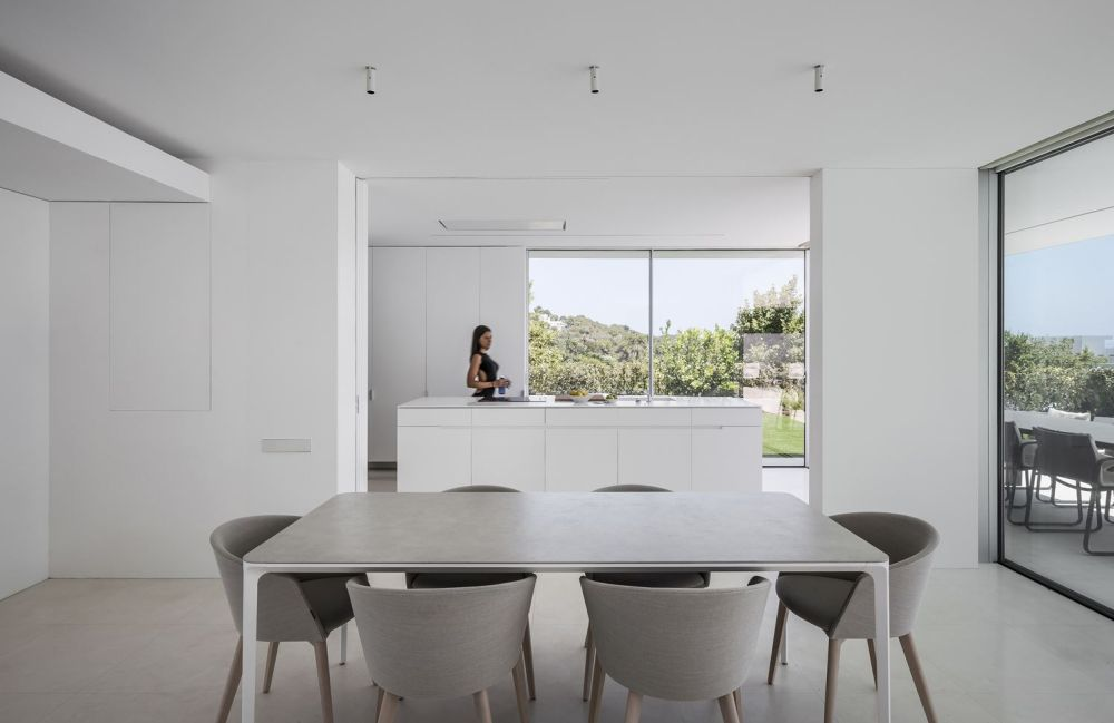 The sliding glass doors bring inside the wonderful views, allowing them to be the center of attention