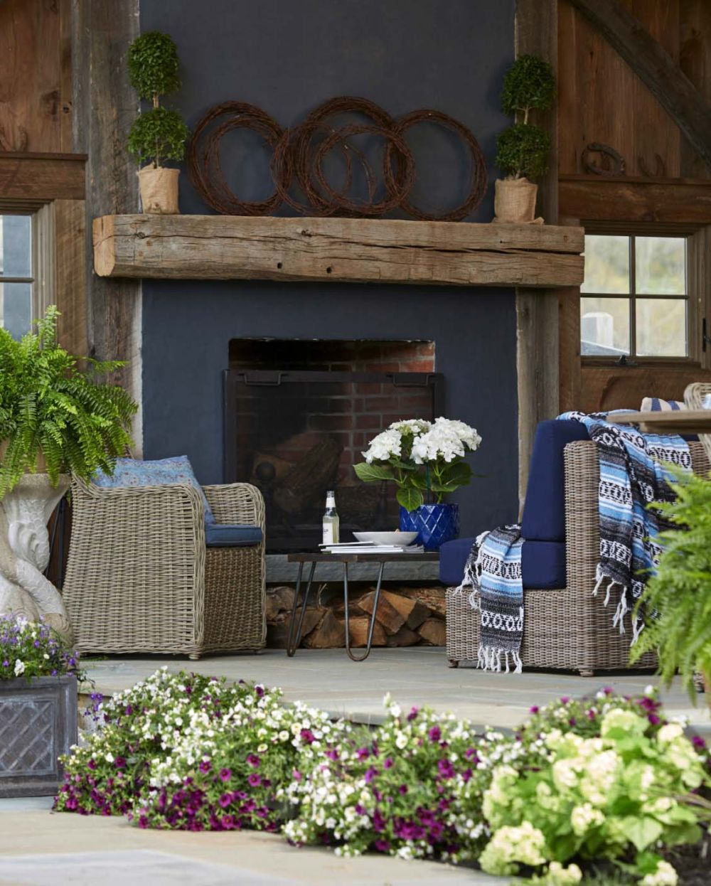 An outdoor fireplace makes the porch feel just a second living room