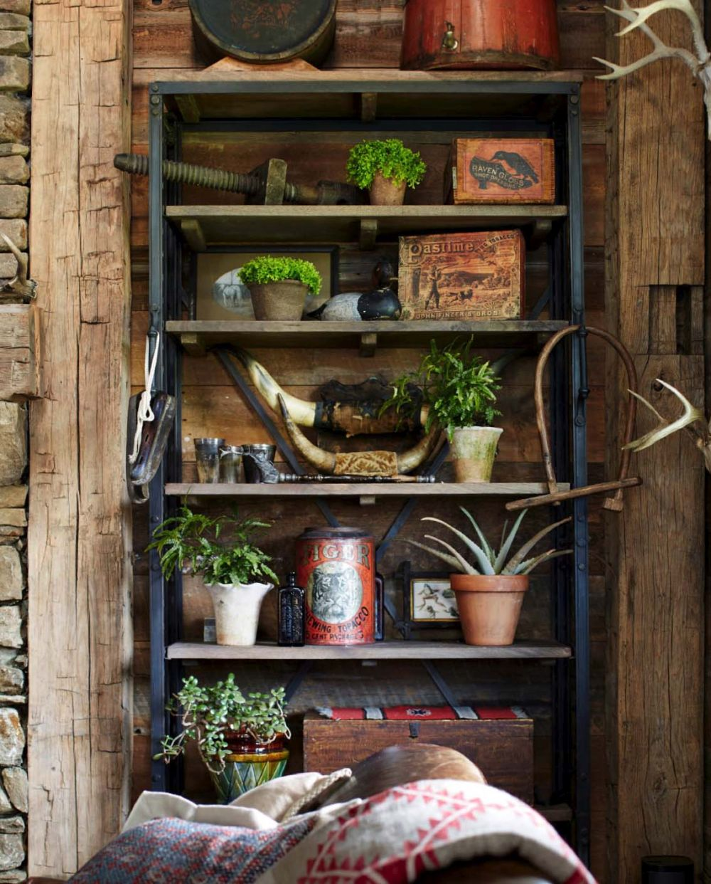 Vintage furniture and antiques are spread throughout the house, creating an authentic rustic interior design