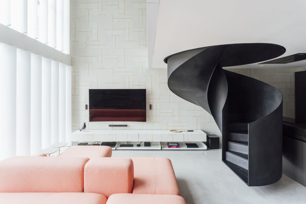 The black spiral staircase is the focal point of the entire apartment