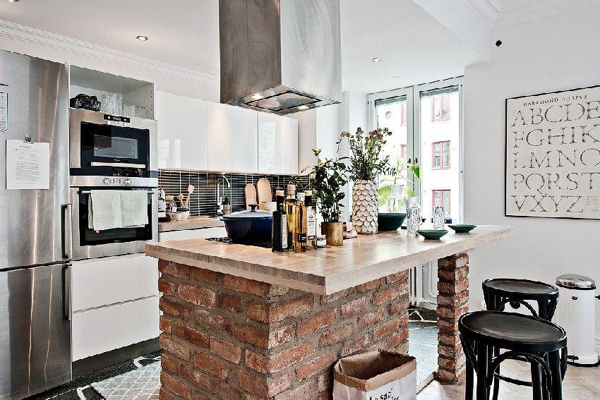 Eye-catching kitchen island with a brick base
