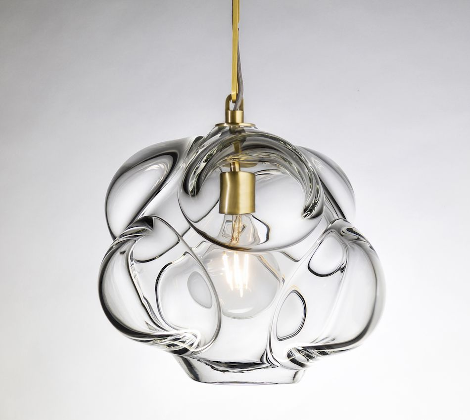 The amorphous shapes in this pendant highlight the beauty of the clear glass.