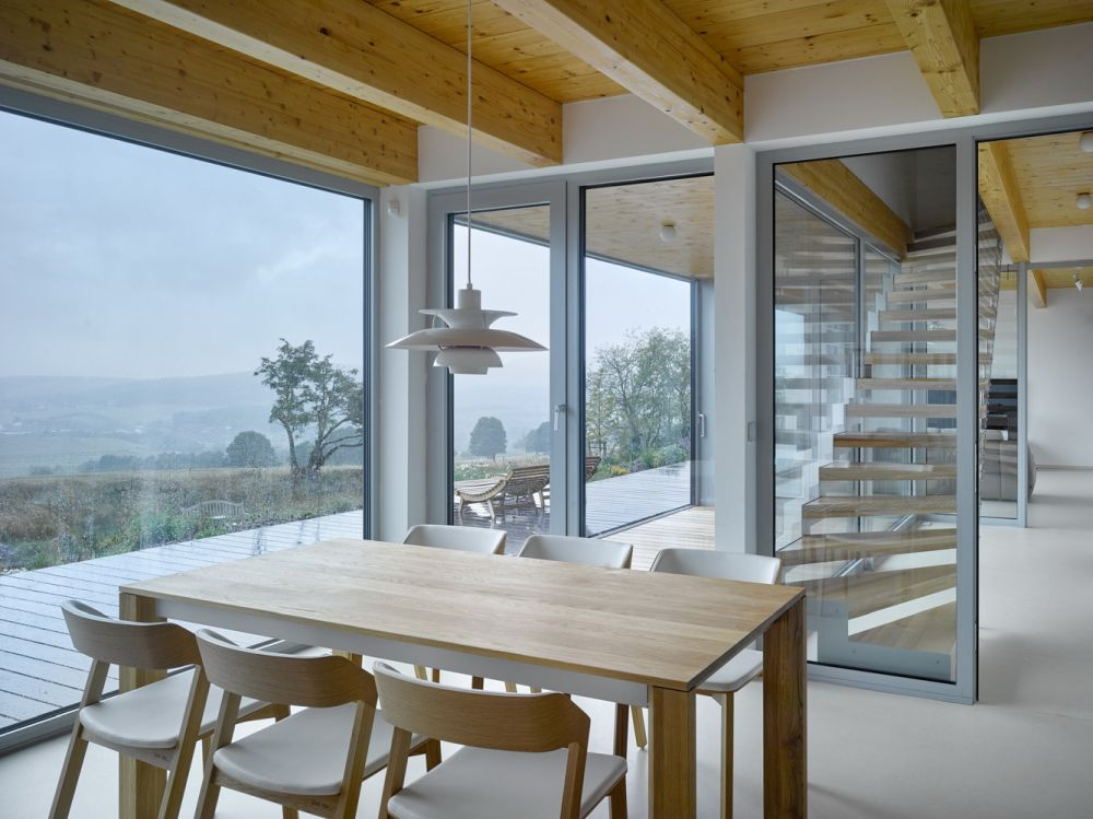 The ground floor spaces are framed by a wooden deck which emphasizes the extraordinary views