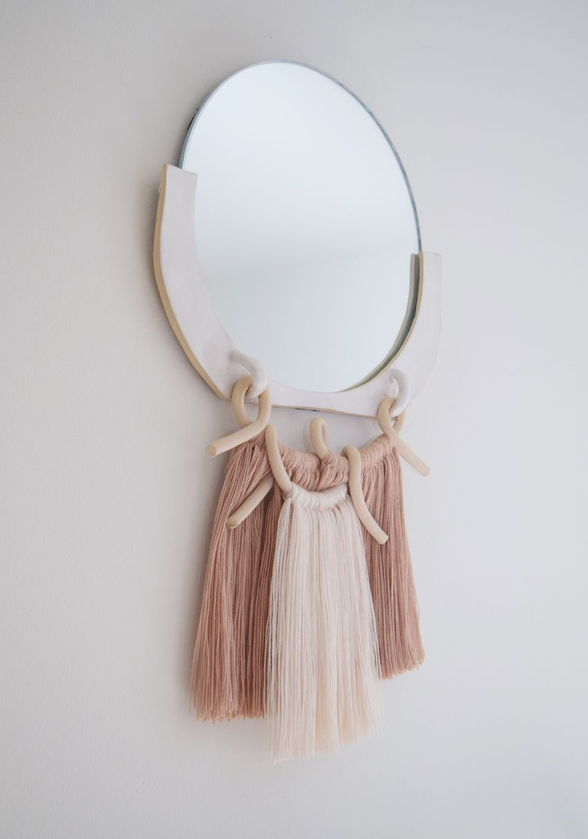A minimalist mirror gets the Boho treatment with fringe.