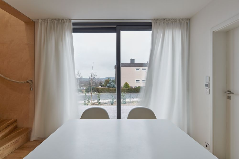 Breezy white curtains can close off the social area for more privacy whenever desired