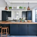 Kitchen with an industrial flair featuring a wood countertop