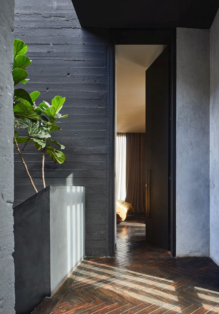 Wood and concrete are the two primary materials that make up the exterior and interior of the house
