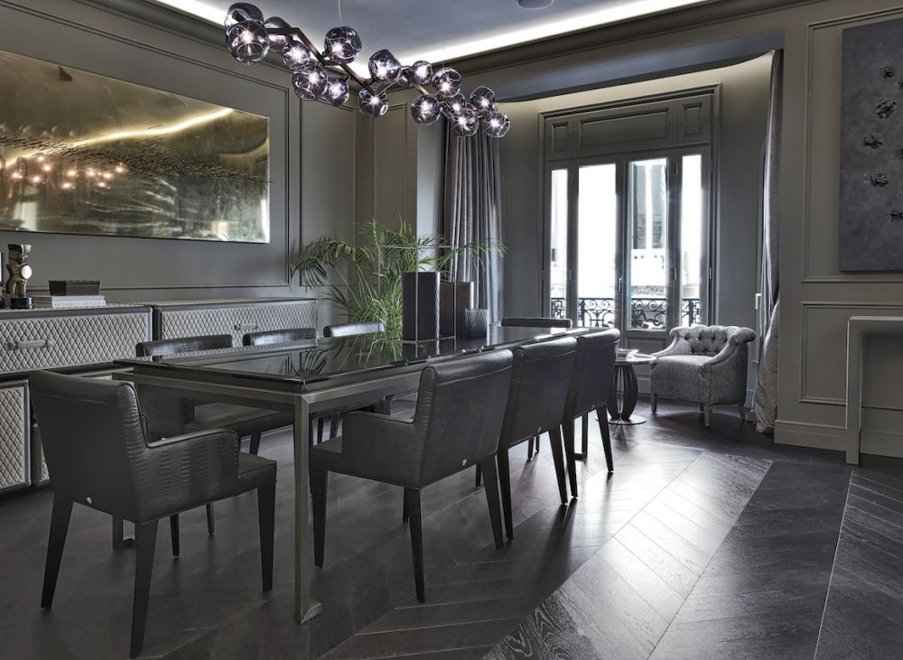 A stunning suspension light accents the dining table and area.