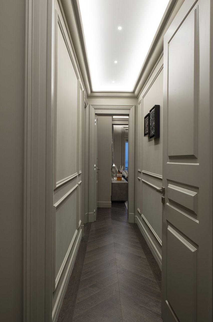 A minimum of art maintains the clean lines of the hallway.