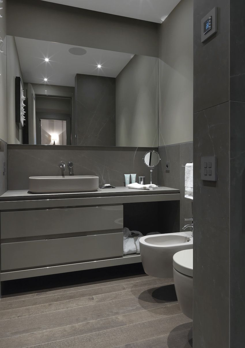 The sleek second bathroom has one basin set atop the vanity.