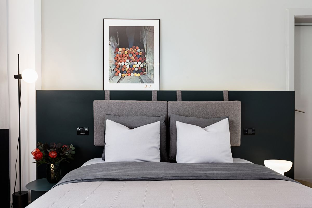 Layering headboard elements increases interest in the bedroom.