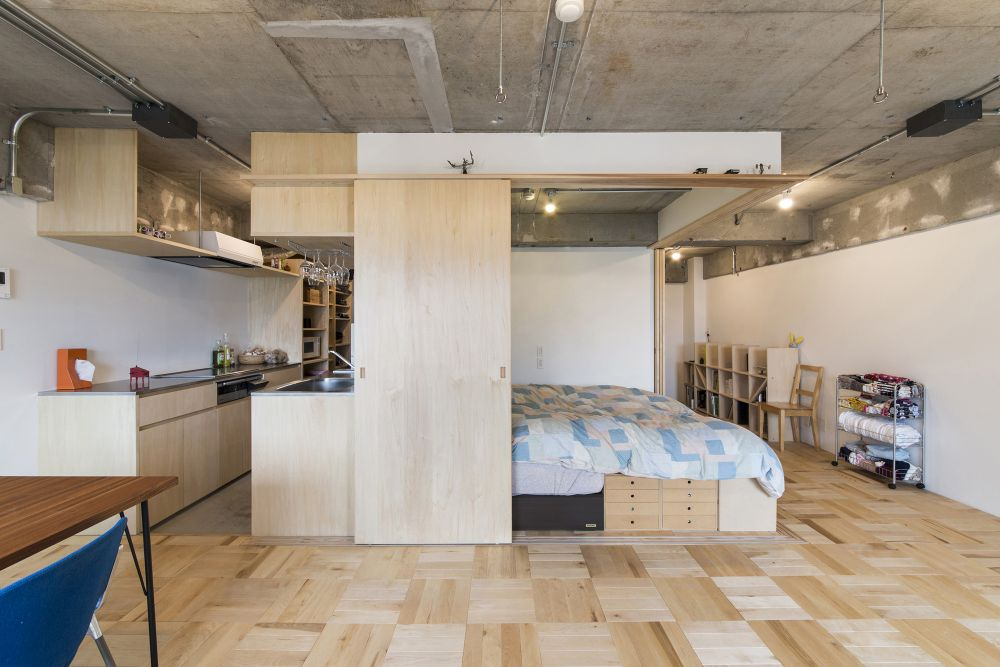 Open-plan social area with a linear kitchen