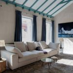 Madrid living room decor with blue curtains