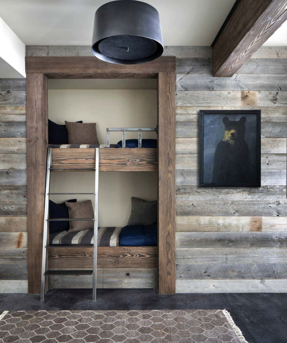 The kids' bedroom features built-in bunk beds which help maximize the floor space