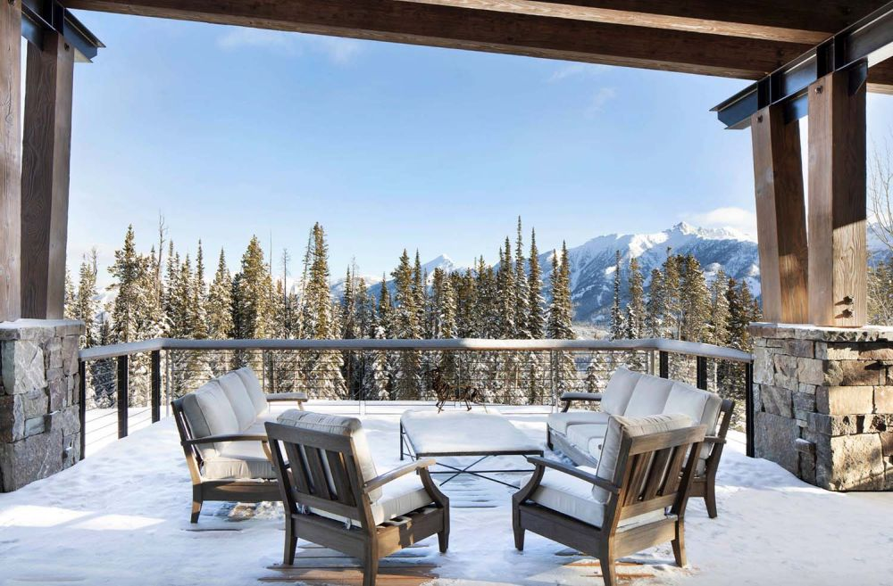 An open balcony captures a wonderful view of the surrounding mountain landscape