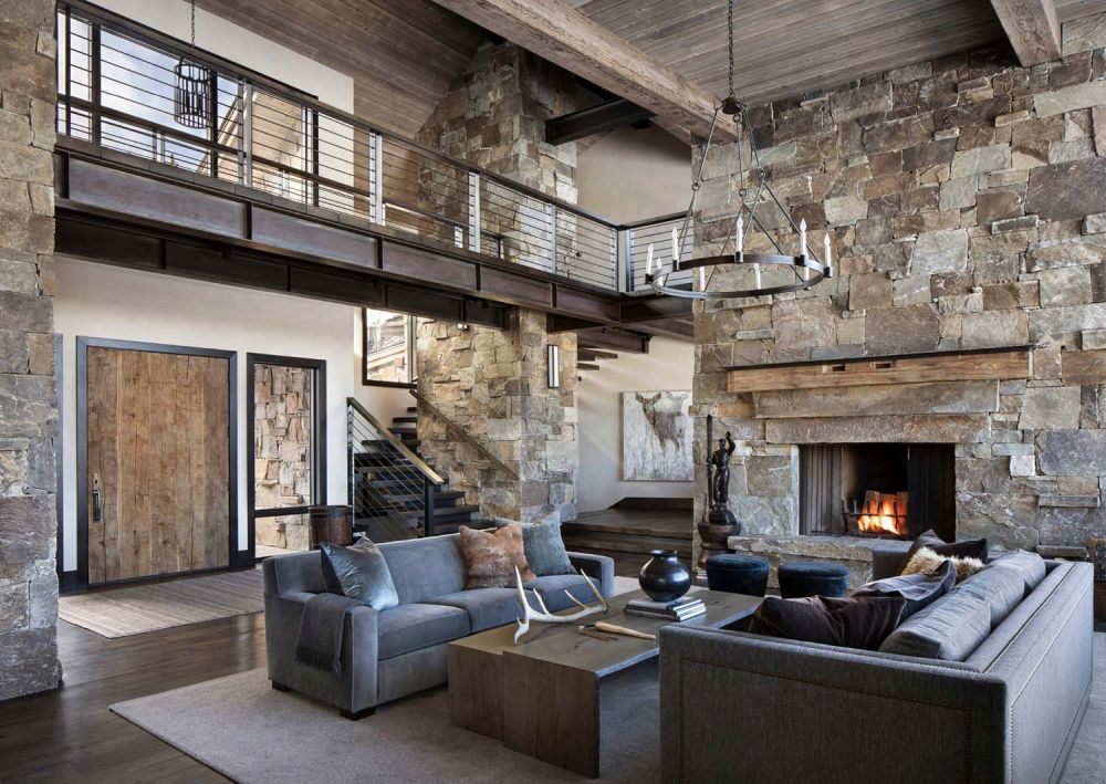 The massive stone fireplace is the focal point of the living room and the entire common area
