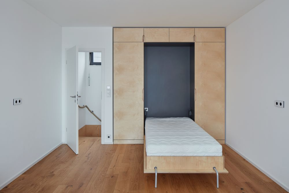 The bed fits into a special nook inside a custom-built storage unit