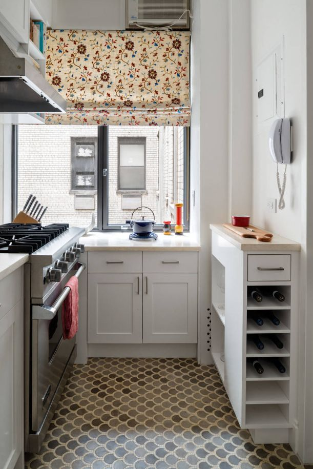Small kitchen with large windows and cute shades