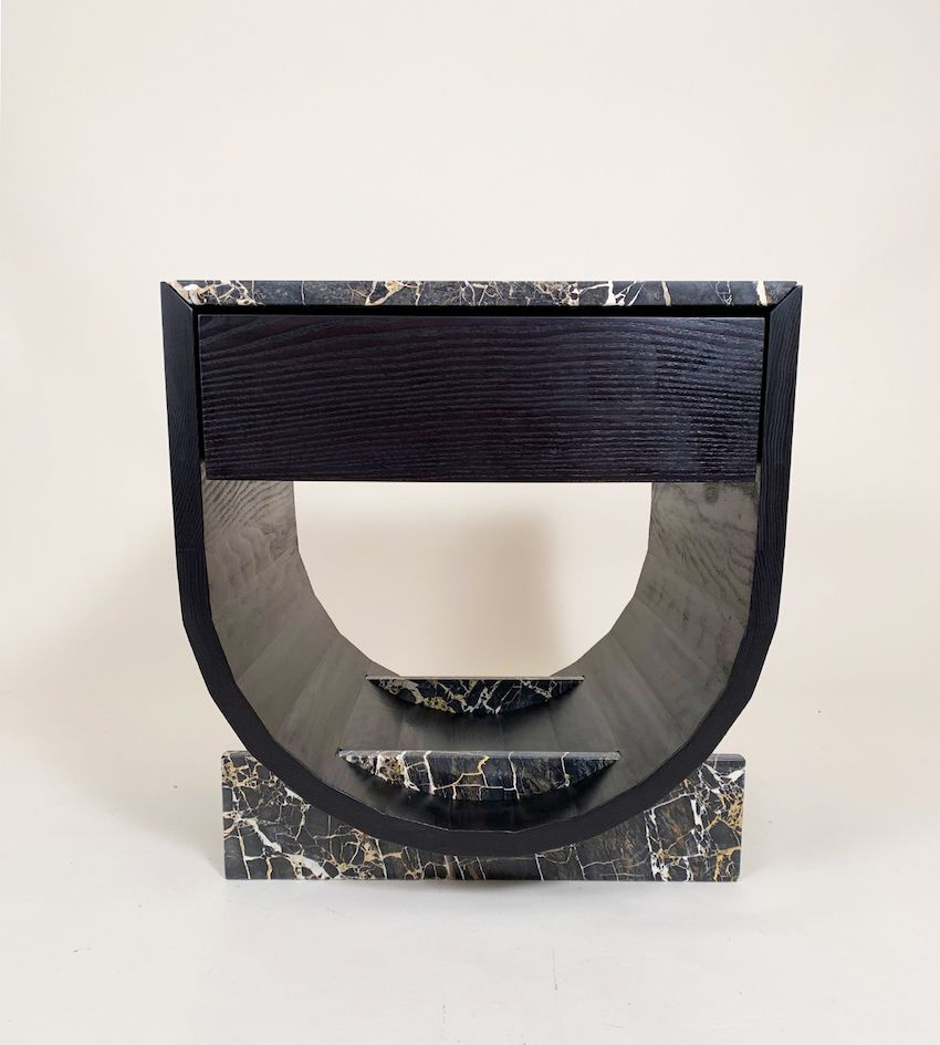Contrasting geometries highlight this modern side table of wood and marble.