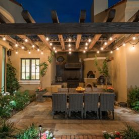 Pergola with solid and big wood beams and string led lights