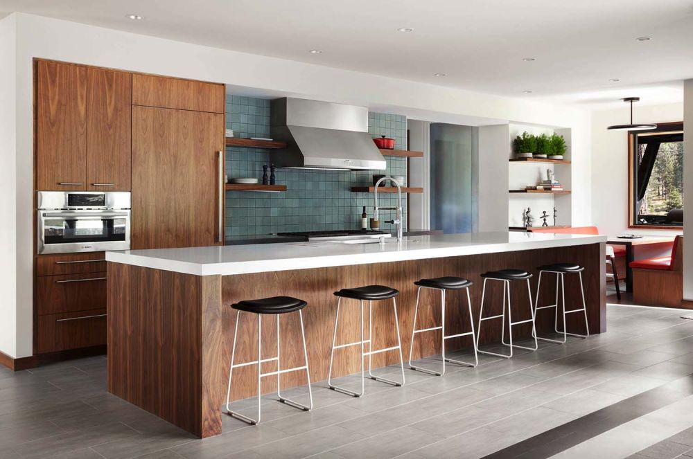 The kitchen island provides most of the counter space and can easily function as a bar when entertaining guests