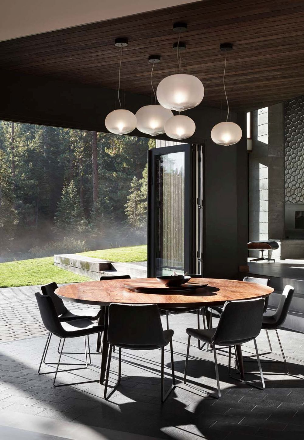 The dining area can be directly connected to the backyard by opening up the folding glass doors