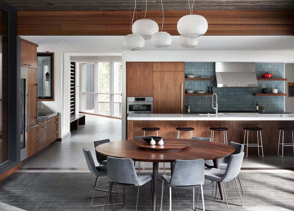 the kitchen is large and has a long island which perfectly frames it and separates it from the dining area