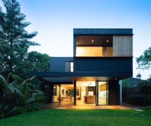 Modern Family House Anchored Between Two Beautiful Gardens