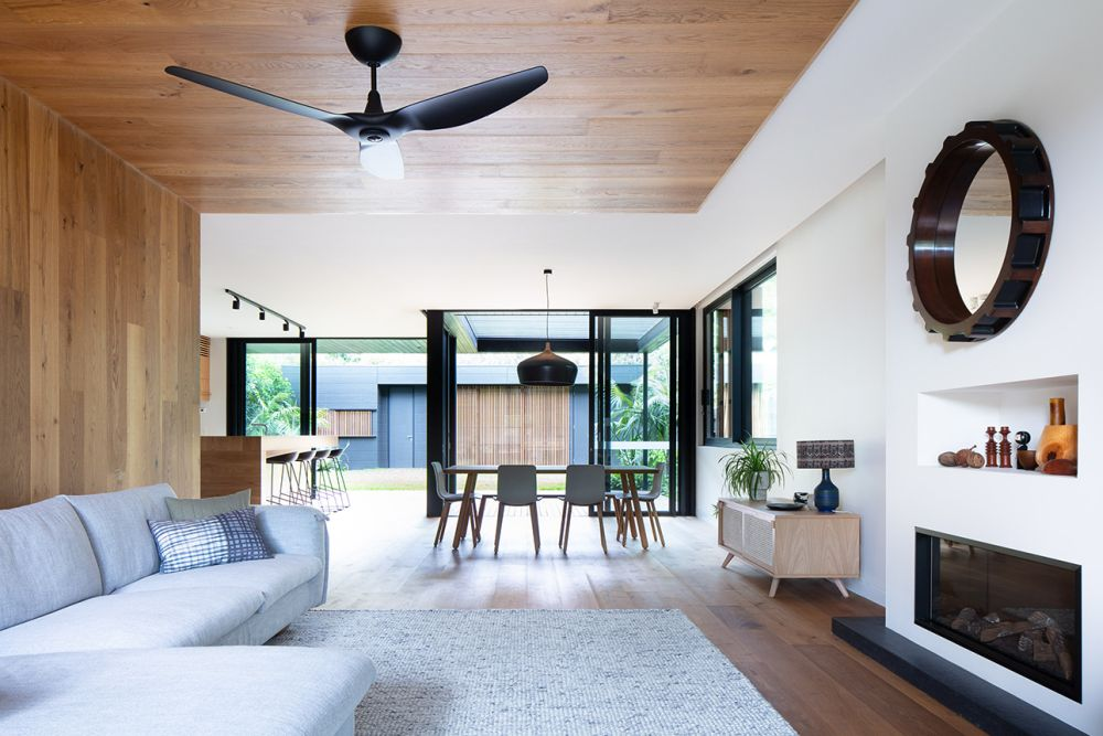 The wood-paneled wall and ceiling make the living room look and feel very warm and welcoming