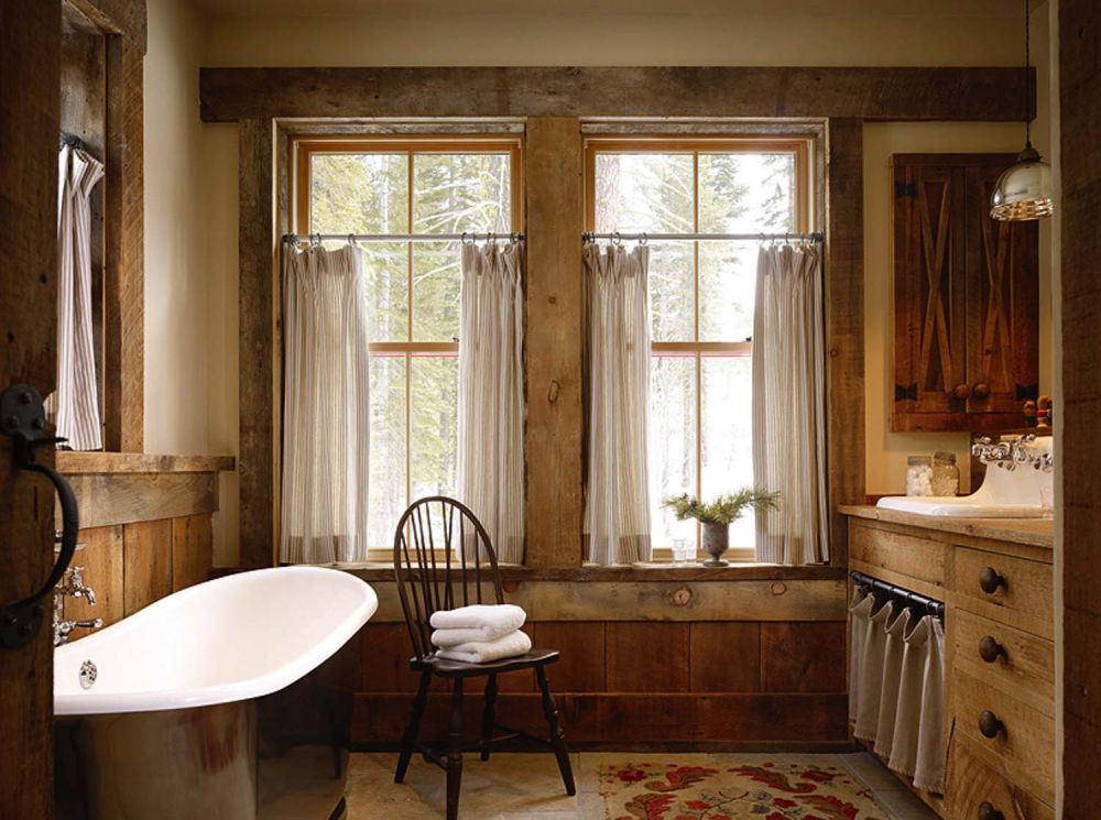 The rustic-industrial design extends into all the rooms of the cabin, including the bathrooms which look surprisingly inviting