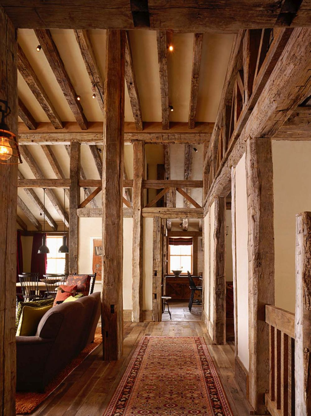 The large beams are made of reclaimed wood and they add a lot of charm to the cabin as a whole