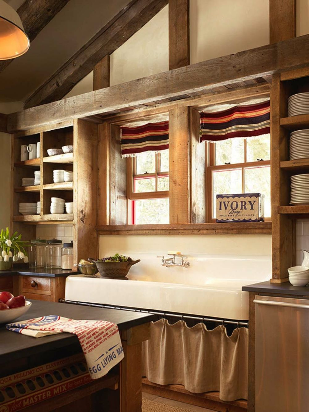 The kitchen has a great layout and features open cabinets and a large farmhouse-style sink
