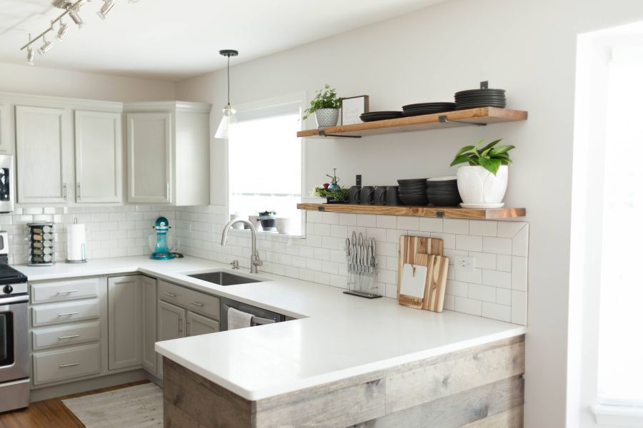 Sleek shelves above the backsplash