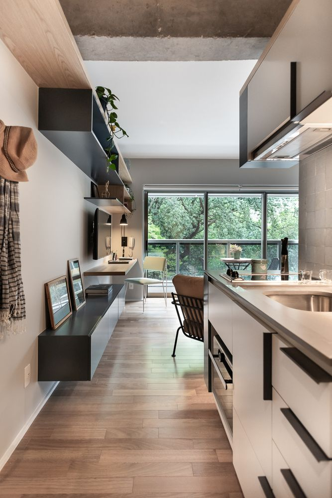 The kitchen is part of an open floor plan and yet feels like its own separate space thanks to the layout