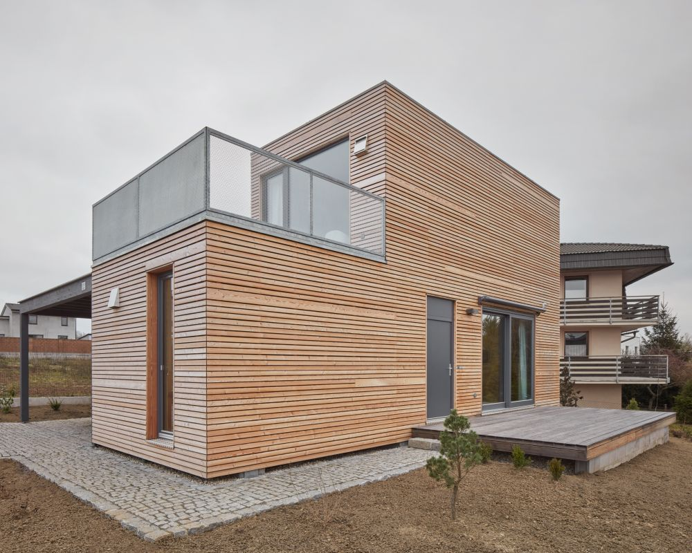 The exterior of the building is clad in larch wood and has a very simplistic appearance