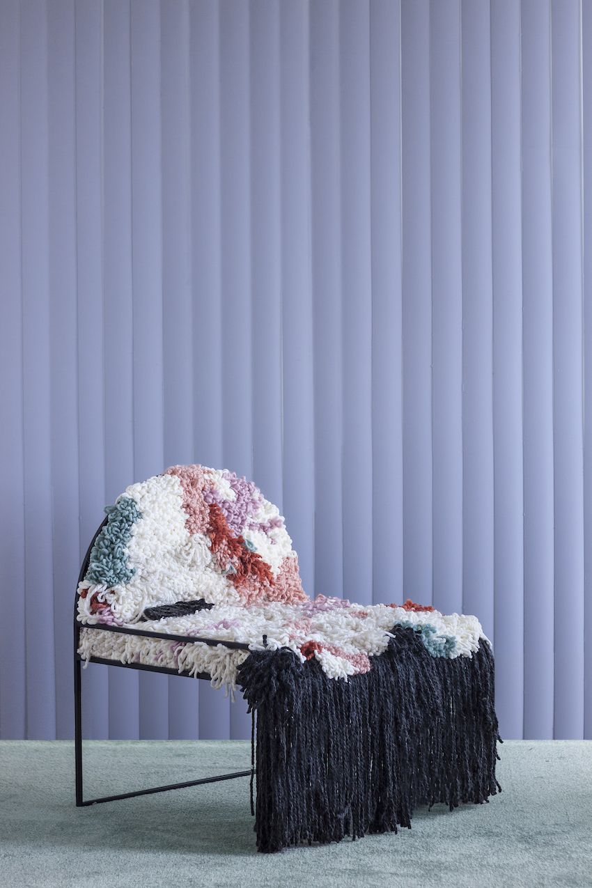 A textural seat and dramatic fringe make this chair distinctive.