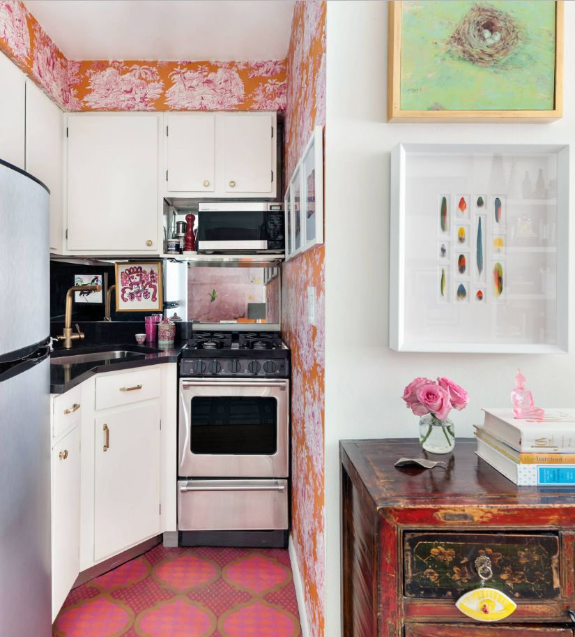 Colorful wallpaper walls and tile floor