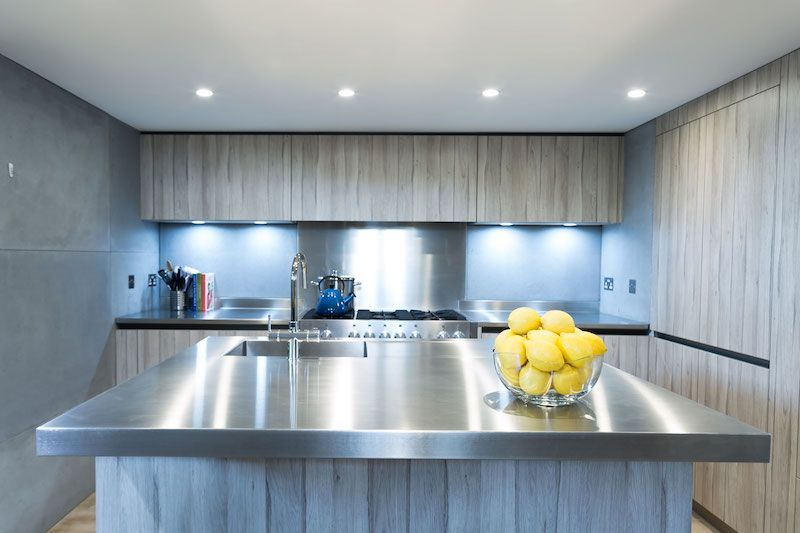 Industrial-style kitchen with stainless steel countertops