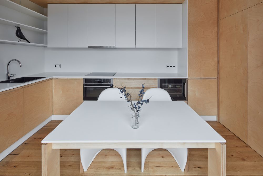 The dining table is generous in size and can double as a kitchen island whenever needed