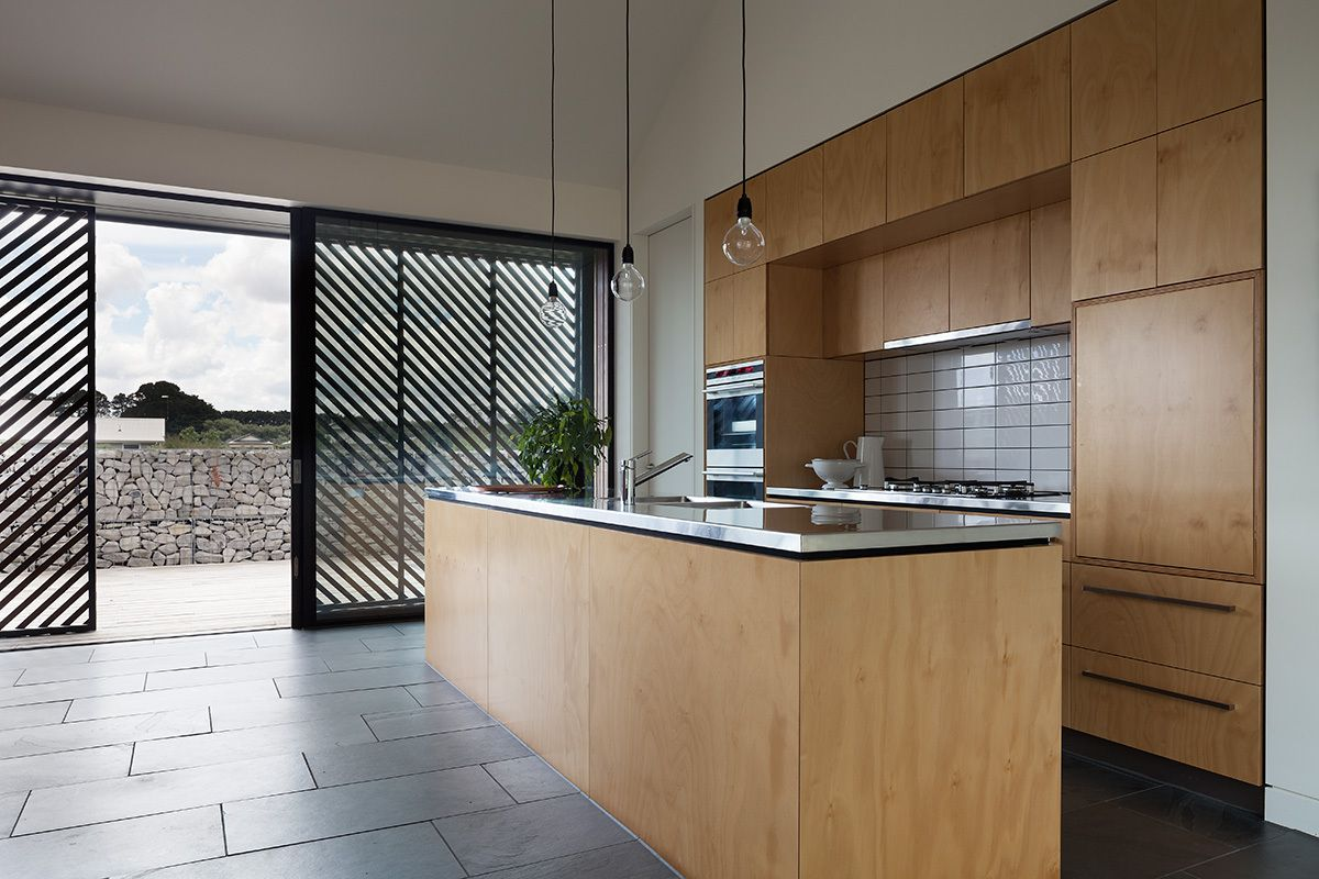 The kitchen has direct access outdoors and is almost completely covered in wood