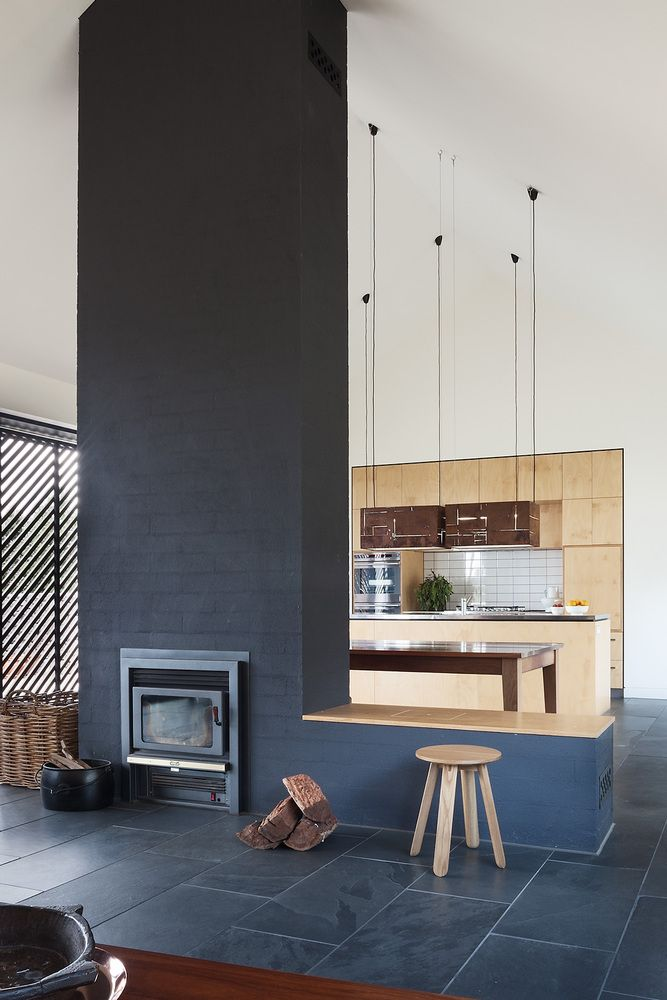 The fireplace wall goes all the way up, becoming a focal point and an important structural element