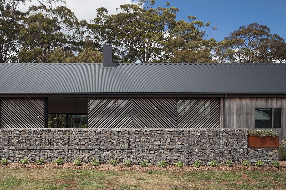 The fence and overall distribution of the windows and openings ensure a comfortable level of privacy