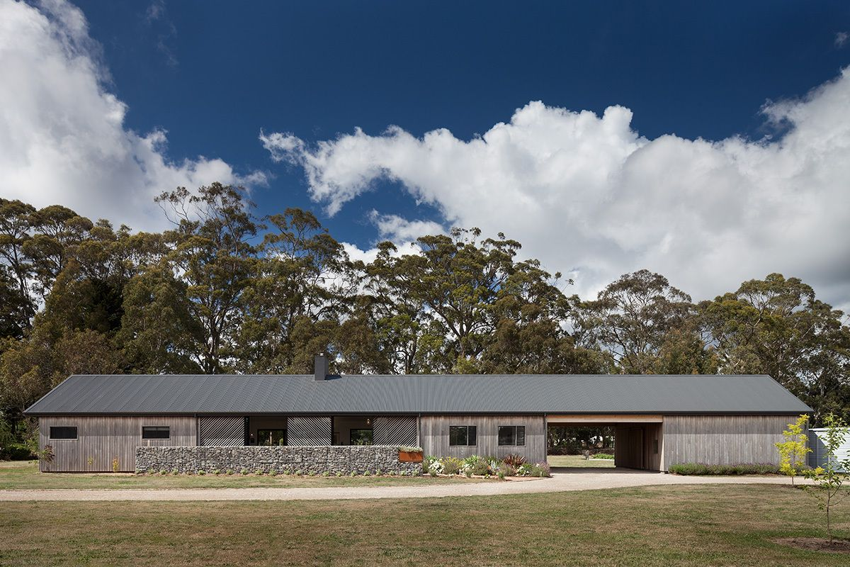 The carport is integrated under the same roof for a nice sense of cohesion